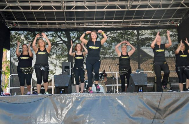 Fitness Vibe Zumba display on the main stage at Cottingham Day